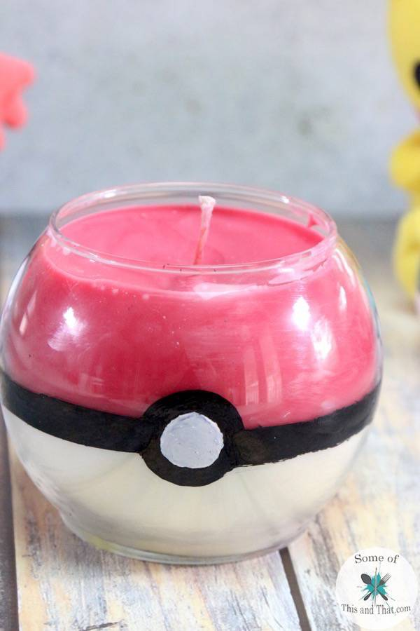 Learn how to make this DIY Pokeball Candle made from Dollar Tree items!